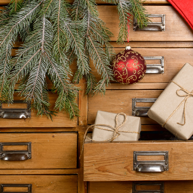 """Christmas gifts in the drawer of a cabinet"" stock image"