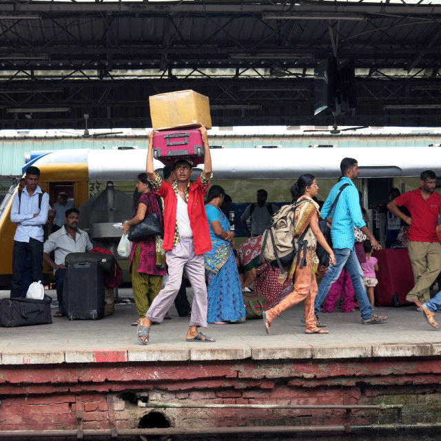 """""""New Dehli Railway Travelers"""" stock image"""