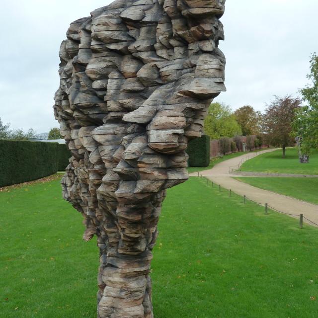 """Narrow wooden sculpture"" stock image"