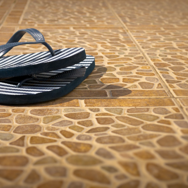 """""""Pair of Flip Flops on a Patio"""" stock image"""