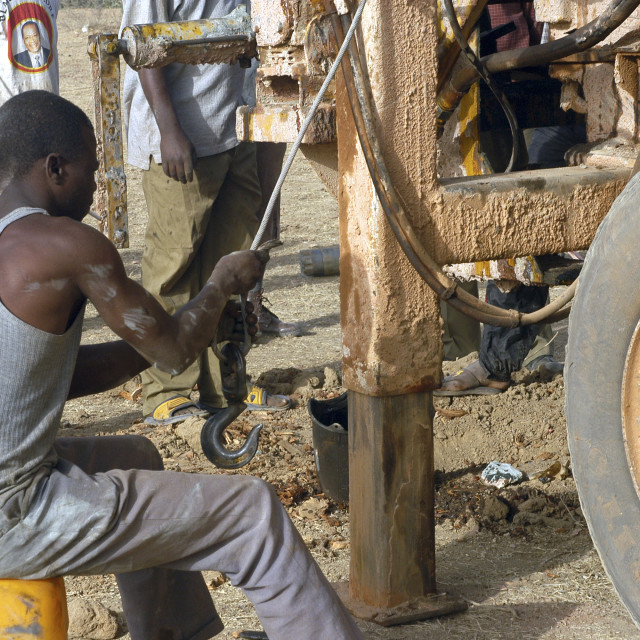 """Drilling of a well in Burkina Faso"" stock image"