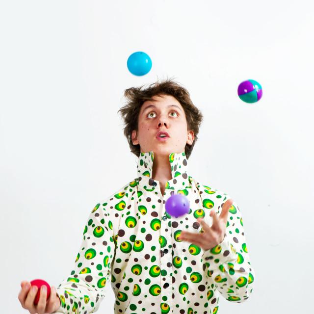 """Juggler Juggling Multicolor Balls"" stock image"