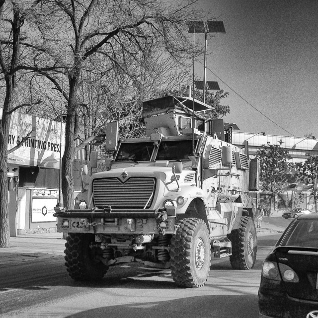 """""""ISAF MRAP mingling with traffic"""" stock image"""
