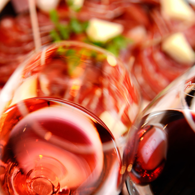"""Red and Pink glass of wine with delicatessen"" stock image"