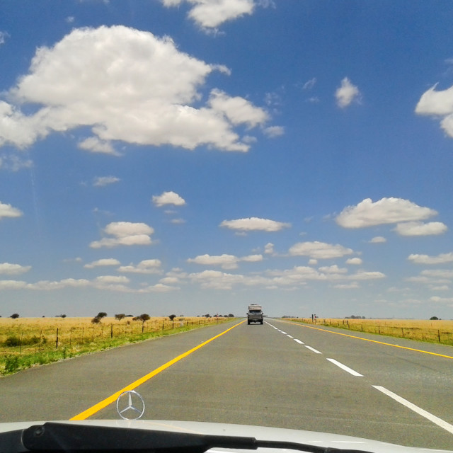"""Road Trip with Blue Sky & White Puffy Clouds"" stock image"