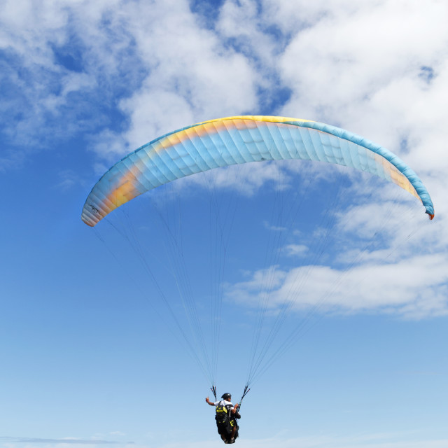 """Paraglider in Blue"" stock image"