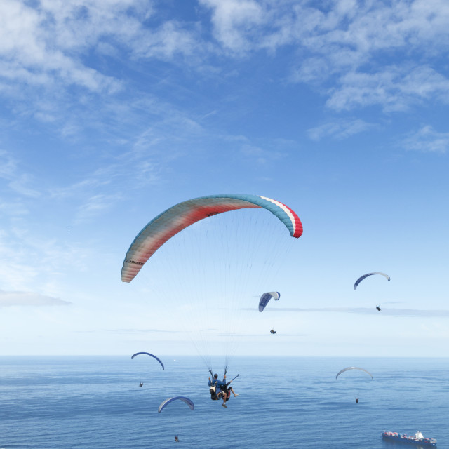 """Group of Floating Paragliders"" stock image"