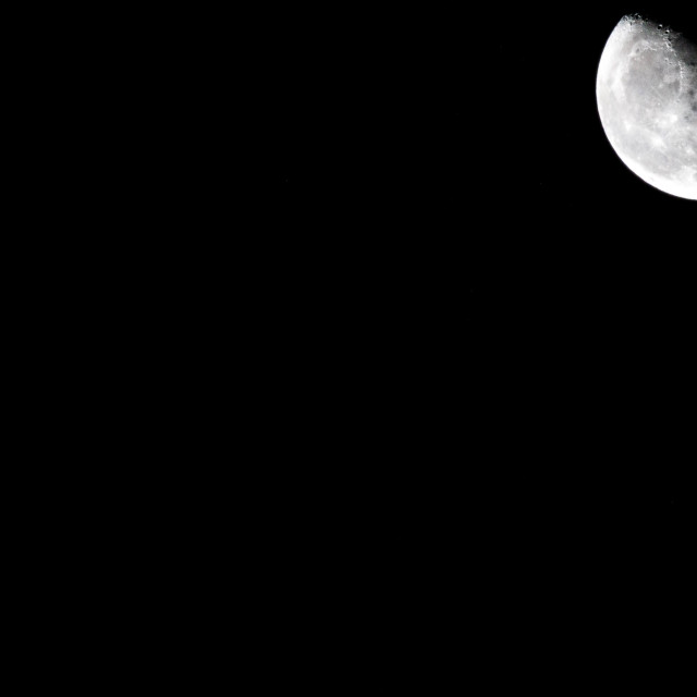 """The moon stands out in complete darkness"" stock image"