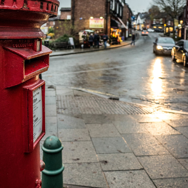 """A red post box in the small town of Lymm, Cheshire"" stock image"