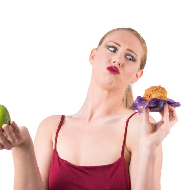 """""""choosing between healthy and fatty food"""" stock image"""