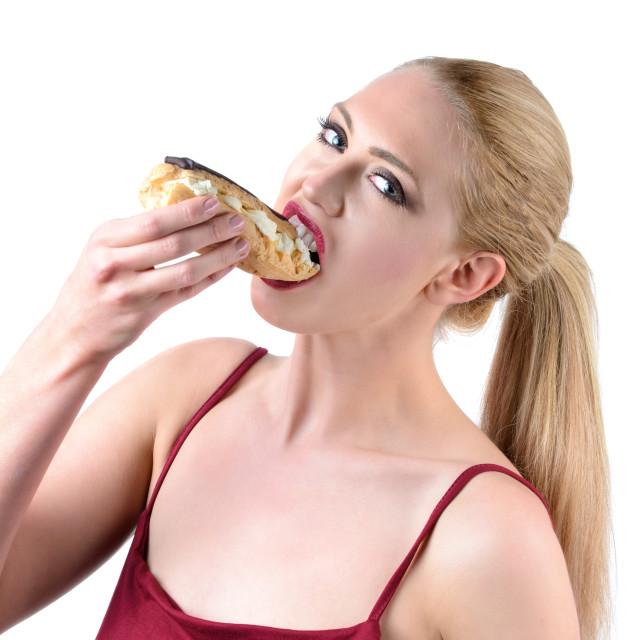 """woman eating cream cake"" stock image"