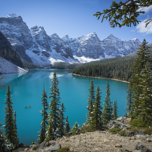 """Moraine Lake with Canoe in Banff National Park"" stock image"