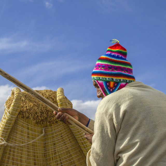 """Boatsman on reed boat in Peru"" stock image"