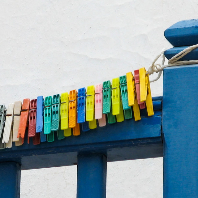 """Colorful clothespins on balcony"" stock image"