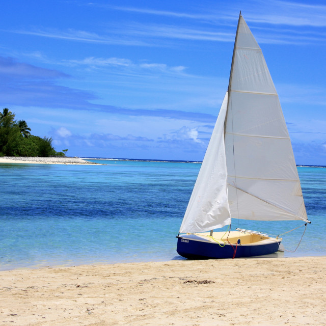 """Sailing boat on Muri Beach, Cook Islands"" stock image"