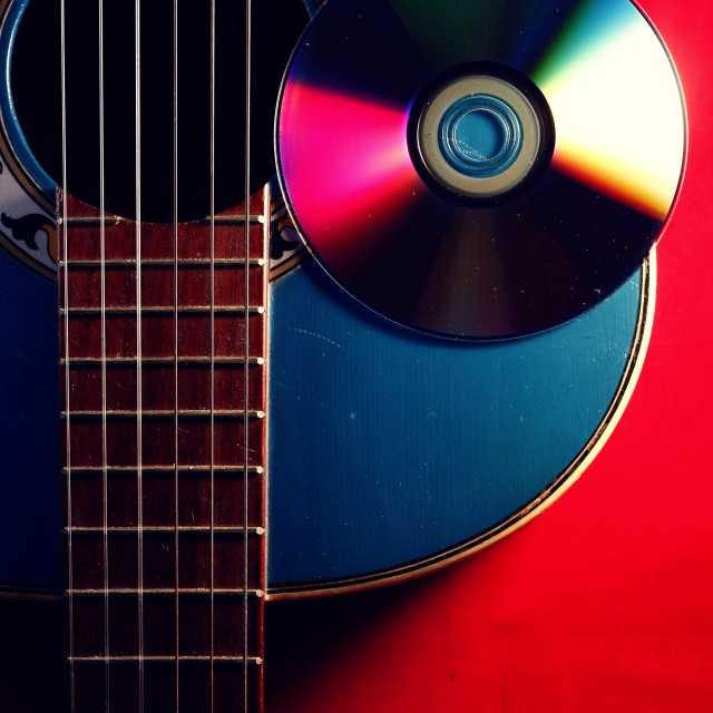 """acoustic guitar and cd"" stock image"