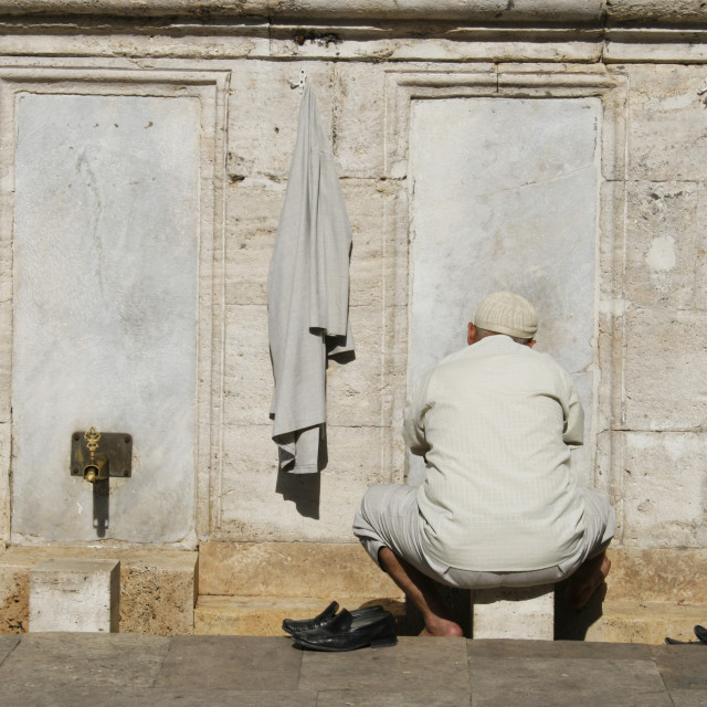 """arab man washing feet near mosque"" stock image"