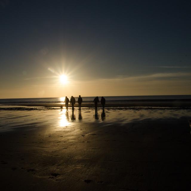"""Sunset beach walk"" stock image"