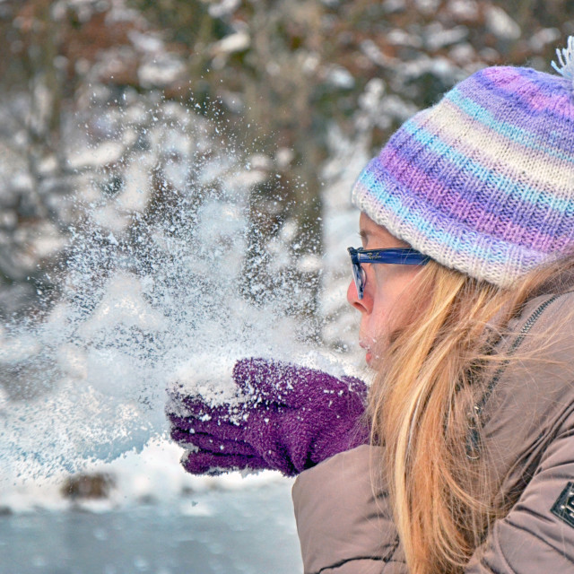 """Woman Blowing A Ball Of Snow"" stock image"