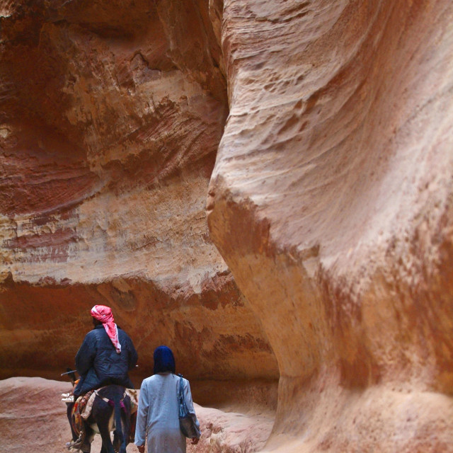 """Petra monastery-Bedouin and ass"" stock image"