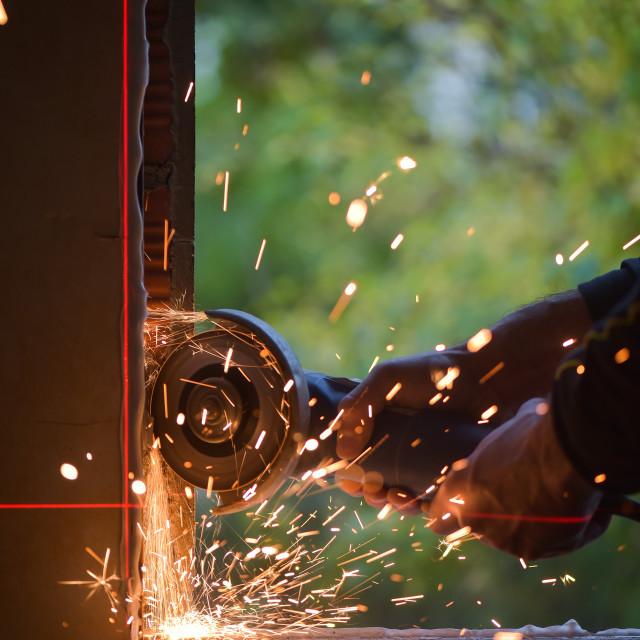 """Window renovation-Metal grinding with orange flying sparks"" stock image"