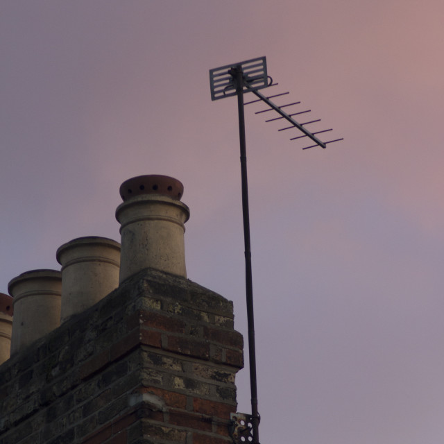 """TV arial antenna chimney roof building sunset"" stock image"