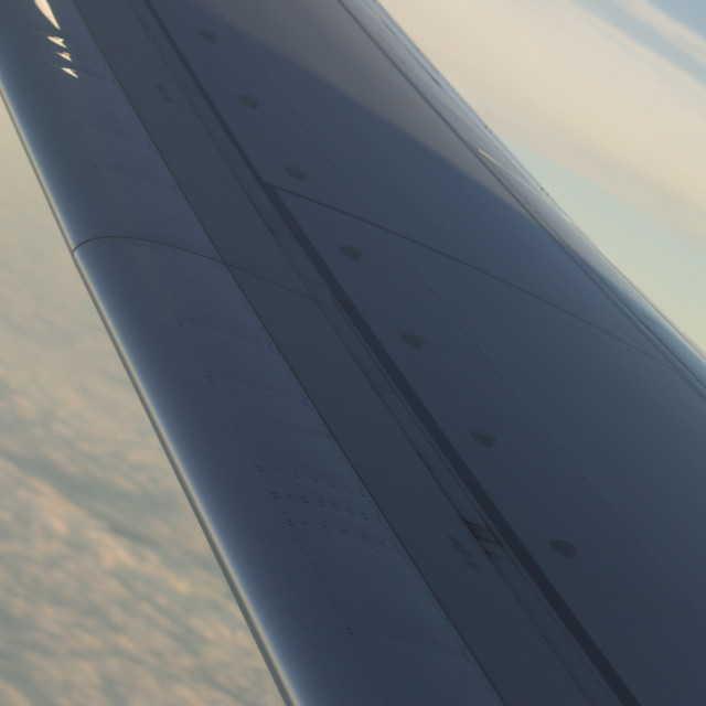 """""""Airplane flying in sky wing in flight"""" stock image"""