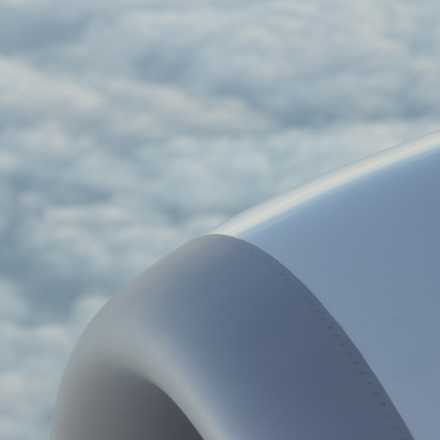 """Airplane flying in sky engine wing"" stock image"