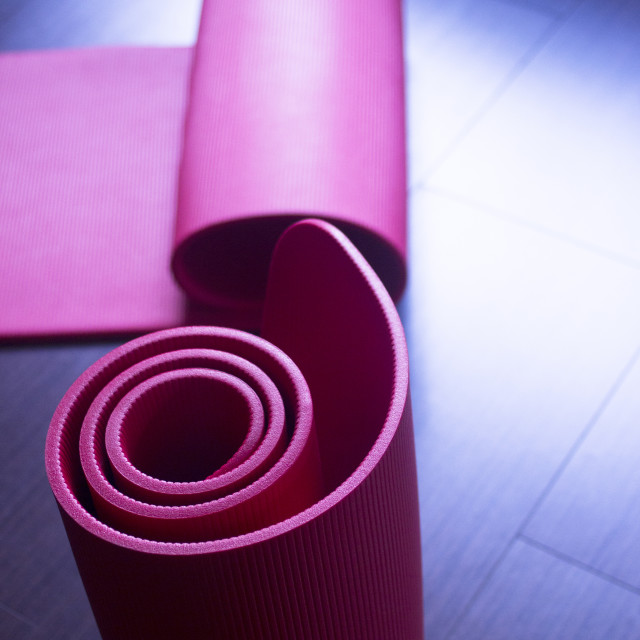 """Red fitness yoga and pilates foam gym mats"" stock image"