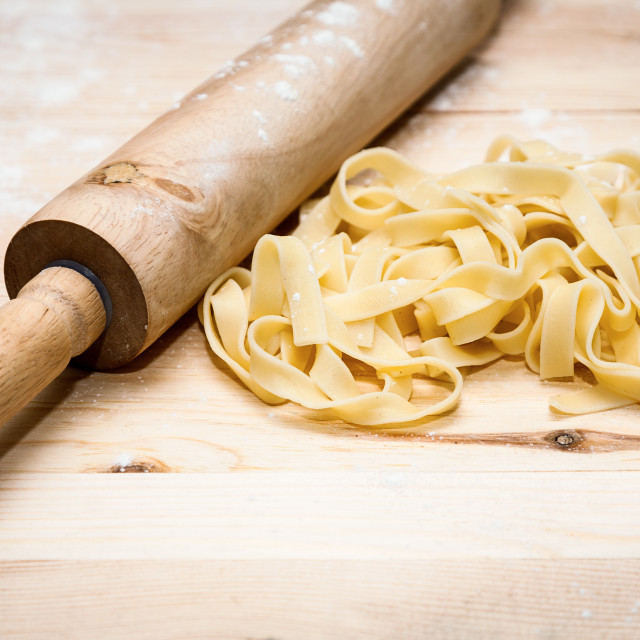 """Fettuccini Italian pasta with parsley and hot peppers"" stock image"