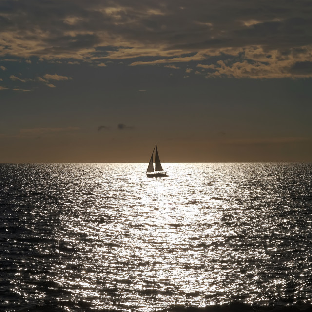 """Sailboat on sunset"" stock image"