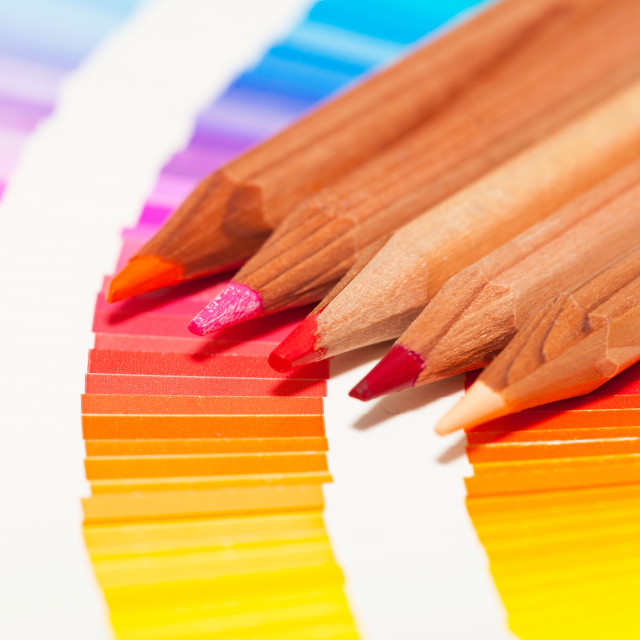 """red and pink colored pencils and color chart of all colors"" stock image"