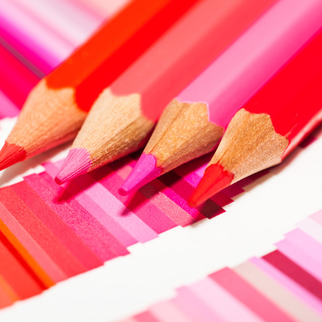 """""""red and pink colored pencils and color chart of all colors"""" stock image"""