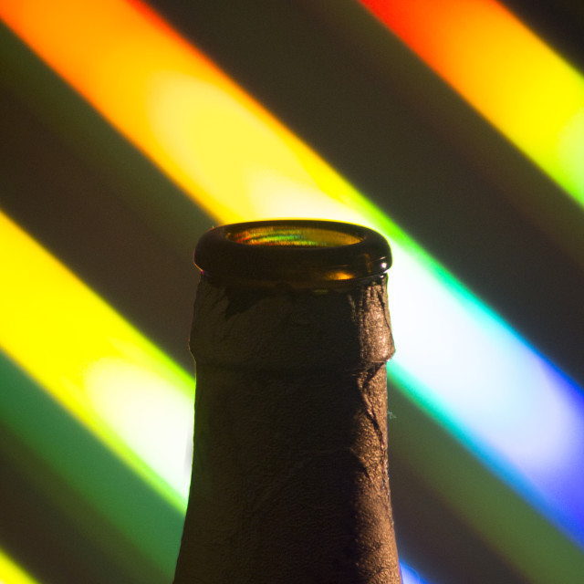 """Beer bottle silhouette on colors"" stock image"