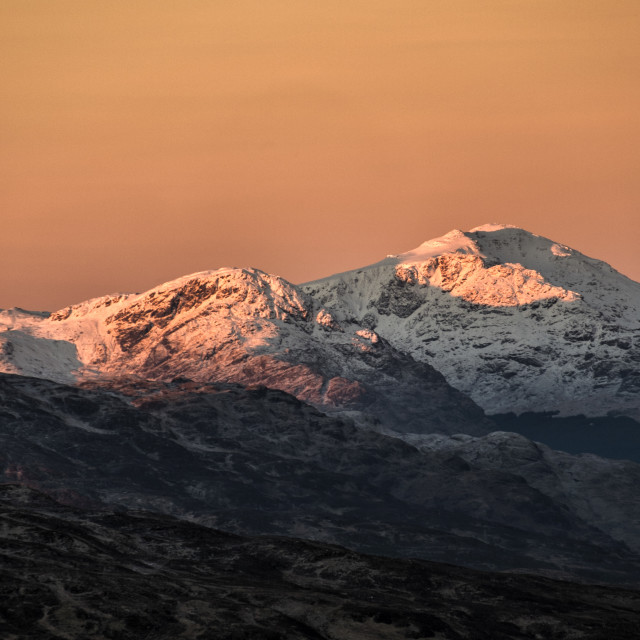 """Dawn over the Snow Covered Mountains in the Trossachs"" stock image"