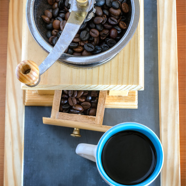 """Cup of coffee, brewed with beans and a coffee grinder"" stock image"