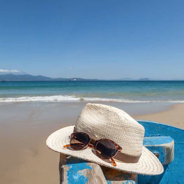 """""""Hat and sunglasses on the beach"""" stock image"""