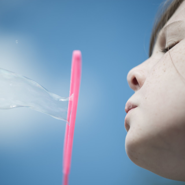 """Blowing bubbles"" stock image"