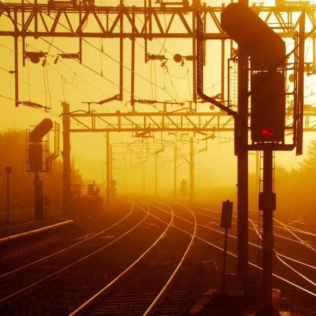 """Railway Train Tracks at Sunrise"" stock image"
