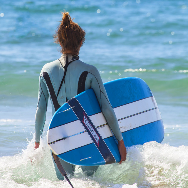 """Girl Going Surfing"" stock image"