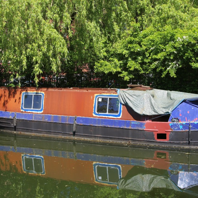 """Narrow Boat under restoration on the Bridgewater Canal"" stock image"