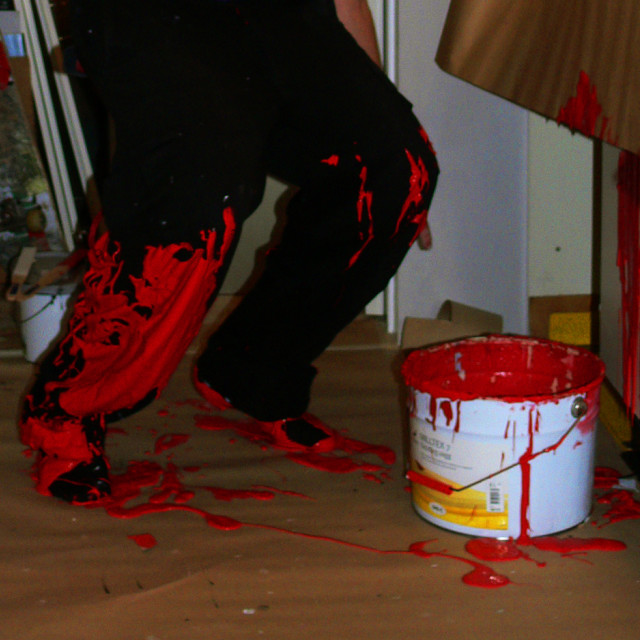 """Fail while standing on paint bucket lid"" stock image"