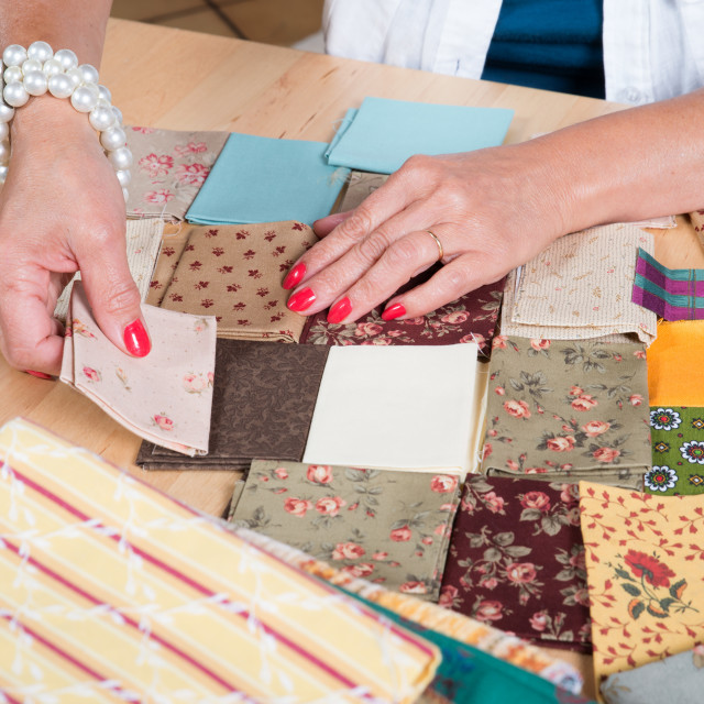 """""""Close up of woman's hand sewing patchwork"""" stock image"""