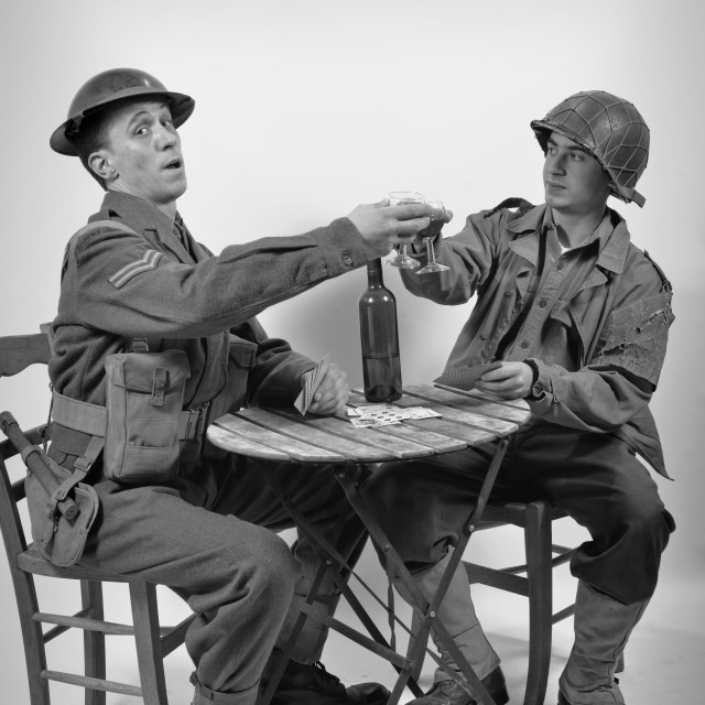"""""""an English soldier and an American soldier drink a glass of wine"""" stock image"""