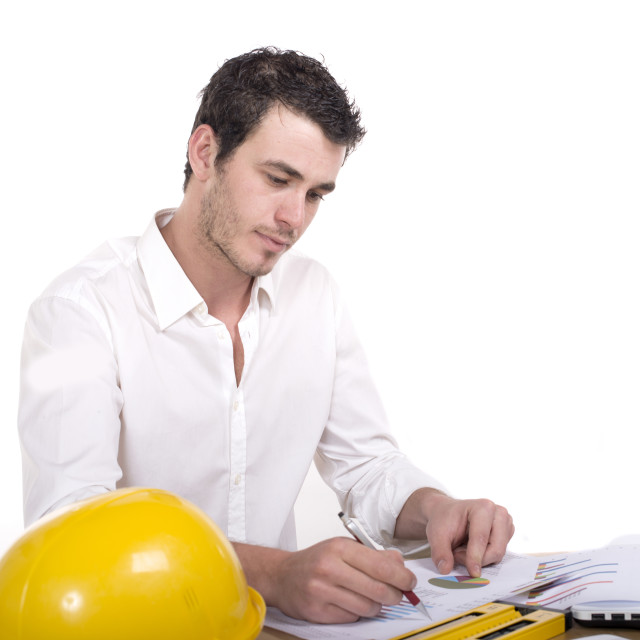 """""""Young architect absorbed in work"""" stock image"""