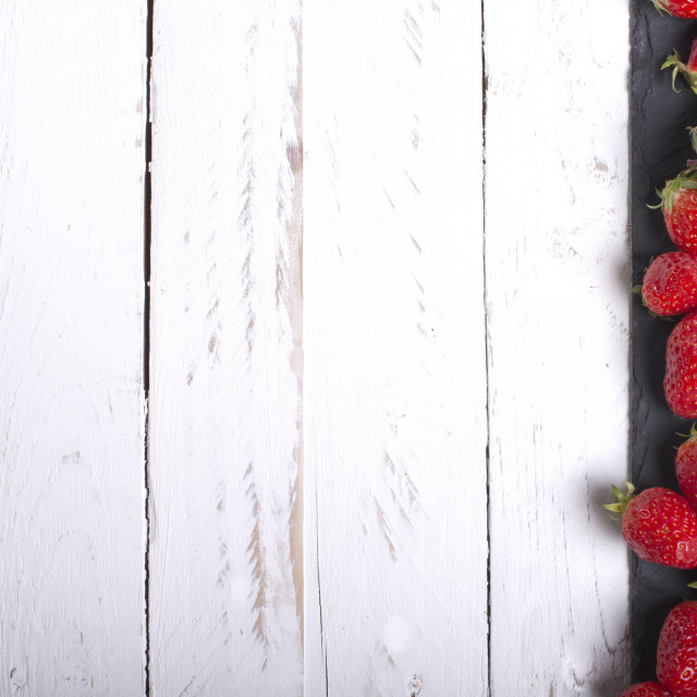 """Strawberries on a white tabletop eve"" stock image"