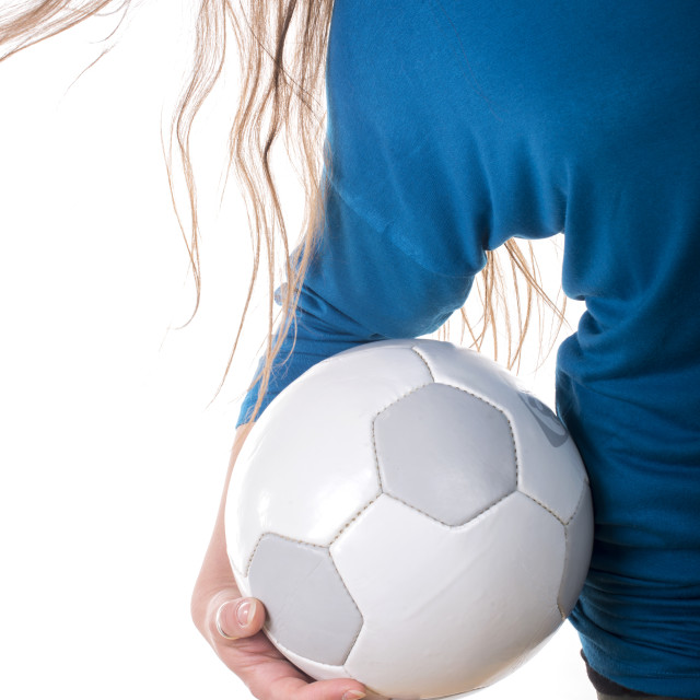 """young woman holding a soccer ball"" stock image"