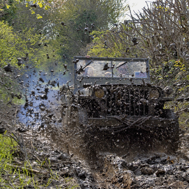 """world war two military vehicle run in mud"" stock image"