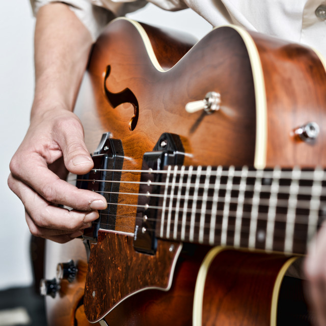 """""""close-up on the fingers of the guitarist"""" stock image"""