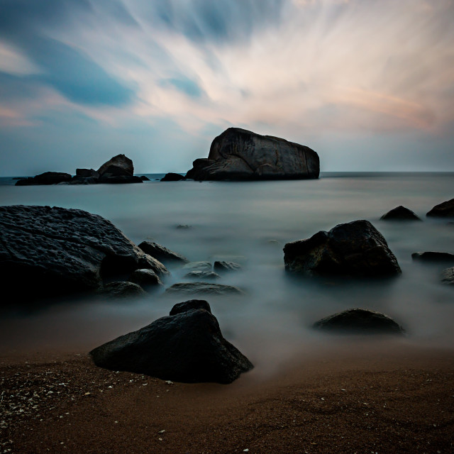 """Boulders in the sunrise"" stock image"
